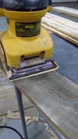 Sanding Pallet Pieces